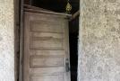 Broken door - stuccoed walls