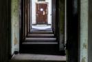 Rooms off of a hallway. Notice the steel door