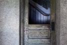 view of stairway through wooden door