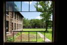 View of outside grounds through broken panes