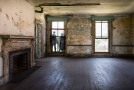 Large room with fireplace. Image taken from doorway there was no admittance to that area
